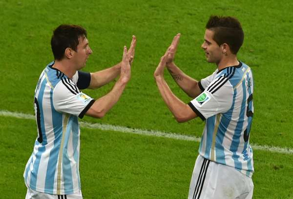 Photo of Fernando Gago  & his friend Lionel Messi