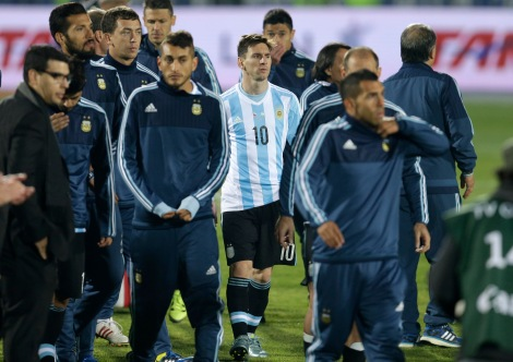 Argentina's Lionel Messi stands with his teammates after the Copa America final game agains Chile at the National Stadium in Santiago, Chile, Saturday, July 4, 2015. Chile's goalkeeper Claudio Bravo made a save and striker Alexis Sanchez converted the winning penalty as host Chile defeated Argentina 4-1 in a shootout after a 0-0 draw in the Copa America final.(AP Photo/Natacha Pisarenko)